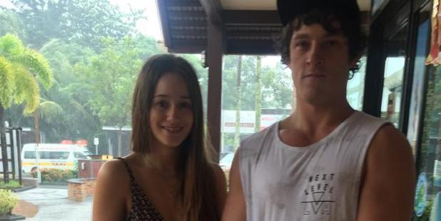 David Coles and Natalie Businsky have been left stranded by the storm. Photo / Emma Reynolds, news.com.au