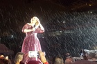 The rain is torrential and Adele is getting soaked but laughing about it as she appeared on stage for her final NZ show.