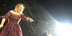 Adele laughs in the face of Auckland's weather at Mt Smart Stadium tonight.