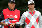Australian Adam Scott (right) with caddie Steve Williams (left) in action during the first round of The Open Golf Championship, 2012. Photo / Actionplus Operations
