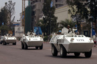 UN troops in armoured vehicles drive through the streets of Kinshasa, Congo. Photo / AP file