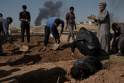 Relatives and friends bury the body of Khadeer, who was killed during fighting between Iraqi security forces and Islamic State militants, on the western side of Mosul, Iraq. Photo / AP