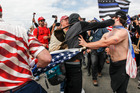 Supporters of President Donald Trump scuffle with counter-protesters during a rally in Huntington Beach, California. Photos / AP
