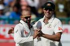 Australia's Nathan Lyon, left, and Pat Cummins celebrate the dismissal of India's Ravichandran Ashwin. Photo / AP