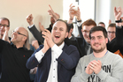 Supporters of the conservative Christian Democratic party CDU cheer after the first exit polls have been published after the election in the German state of Saarland. Photo / AP