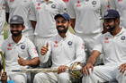 India's captain Virat Kohli as the Indian team pose with the number one ranking trophy. Photo / AP