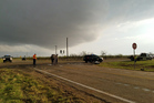 Texas Department of Public Safety troopers investigate a two-vehicle crash that left several storm chasers dead, near Spur, Texas. Photo / AP
