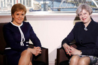 Britain's Prime Minister Theresa May, right, and Scotland's First Minister Nicola Sturgeon during a meeting in Glasgow, Scotland this week. Photo / AP