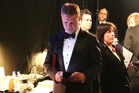 PwC accountant Brian Cullinan holds red envelopes under his arm while using his cellphone backstage at the Oscars. Photo/AP