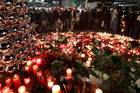 People in front of a memorial near to where a truck ran into a crowded Christmas market in Berlin, Germany killing 12. Photo / AP