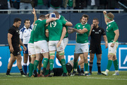 Ireland celebrate second-five Robbie Henshaw's try against the All Blacks in Chicago. Photo / Brett Phibbs