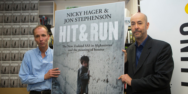 Authors Nicky Hager, left, and Jon Stephenson with their book, Hit & Run. Photo / Mark Mitchell