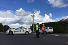 Emergency services at the scene of the three-car crash on Don Buck Rd in Massey this afternoon. Photo/ Moana Tapaleao