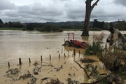 A tractor is submerged as flash flooding inundated rural south Auckland on Wednesday. Photo / Doug Sherring
