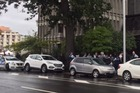 Angry scenes outside Christchurch Court House after trio appear in court on murder charges.