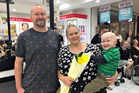 BALD AND BEAUTIFUL: Danniel Bourke and Chilani Hare with their son Olly after the shave.
