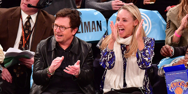 Michael J. Fox and wife Tracy Pollan attend a New York Knicks game. Photo / Getty