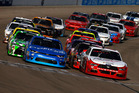 Joey Logano and Kyle Larson lead the field to a restart. Photo / Getty Images