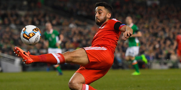 Welsh footballer Neil Taylor is quite different to the Neil Taylor who was bombarded with abuse on Twitter following his namesake's horror tackle on Seamus Coleman. Photo / Getty Images.