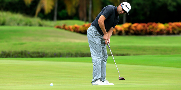 Tim Wilkinson attempts a putt on the ninth green at the Puerto Rico Open. Photo / Getty
