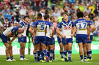 Bulldogs players look dejected after the final Sea Eagles try. Photo/Getty Images