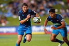 Michael Collins and Rieko Ioane in action for the Blues during their win over the Bulls in Albany last night. Photo / Getty Images.