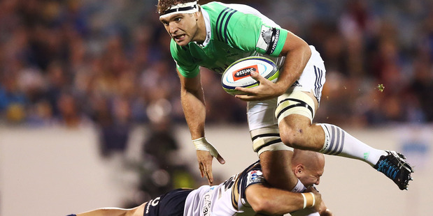 Luke Whitelock of the Highlanders is tackled by Robbie Abel of the Brumbies. Photo / Mark Metcalfe