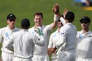 Matt Henry is congratulated on taking the wicket of Temba Bavuma. Photo / Getty Images.