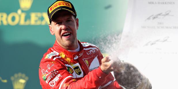 Sebastian Vettel celebrates his win on the podium during the Australian F1 Grand Prix. Photo / Getty Images