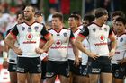 The Warriors looks dejected after a Dragons try. Photo / Getty