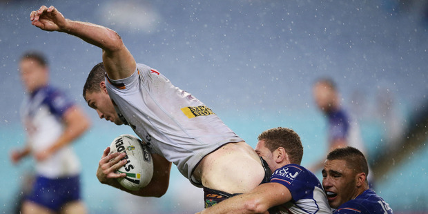 Corey Oates of the Broncos is tackled by Brenko Lee of the Bulldogs. Photo / Getty