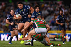 Kiwi lock Jason Taumalolo of the Cowboys is tackled by Jason Clark and Tom Burgess of the Rabbitohs. Photo/Getty Images