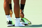 Rafael Nadal of Spain loses his shoe against Fabio Fognini of Italy. Photo/Getty Images