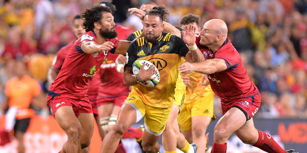 Matt Proctor of the Hurricanes breaks through the Reds defence. Photo / Getty