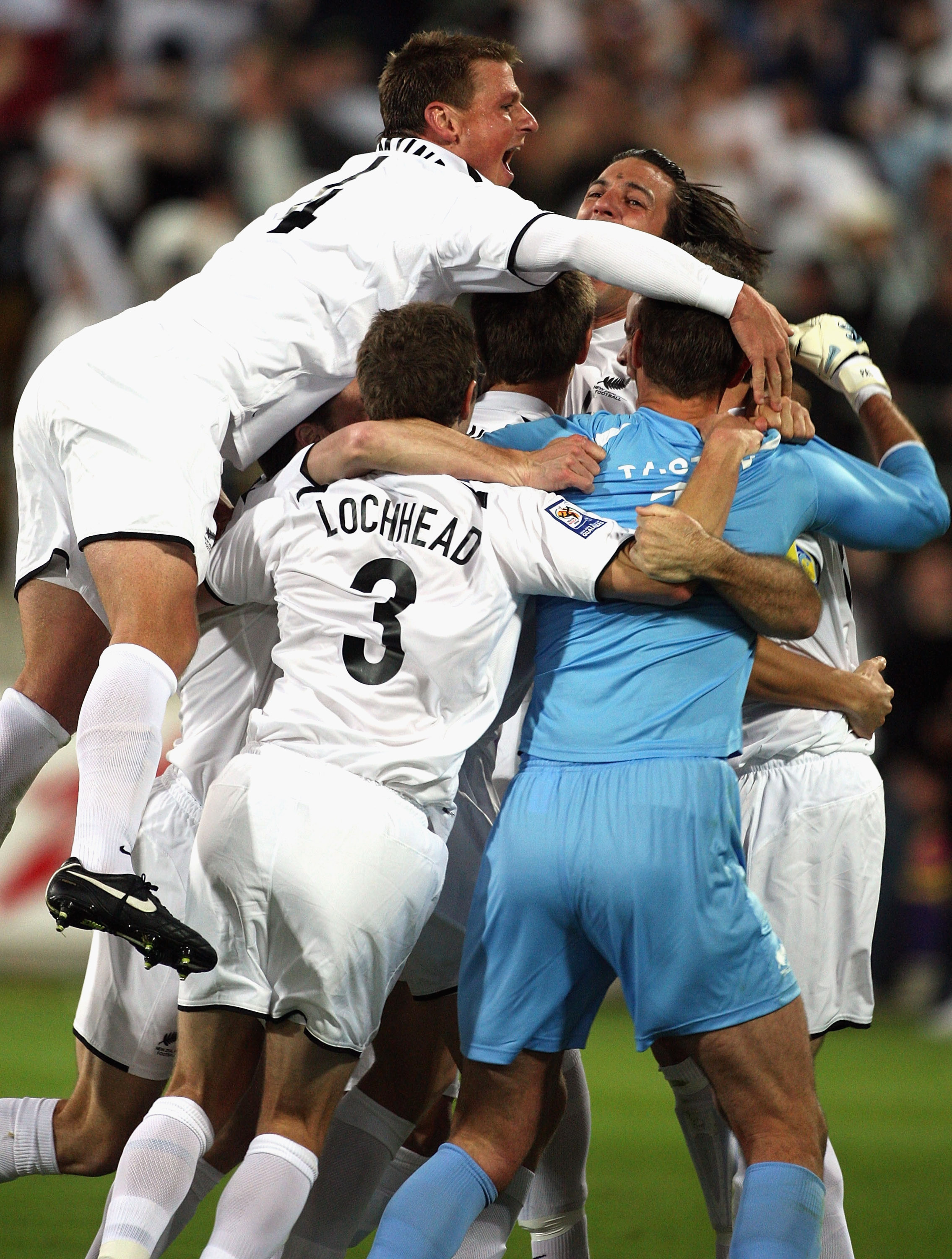 The All Whites celebrate after defeating Bahrain in the inter-confederation playoffs in Wellington in 2009. Photo / Getty Images.