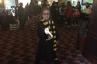Zoe Ryall, 8, dressed as a Gryffindor student for the Harry Potter movie marathon.