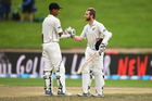 New Zealand captain Kane Williamson celebrates his century with Jeet Raval on Day 3 of the 3rd test match between New Zealand Black Caps and South Africa. Photo / Andrew Cornaga - Photosport.