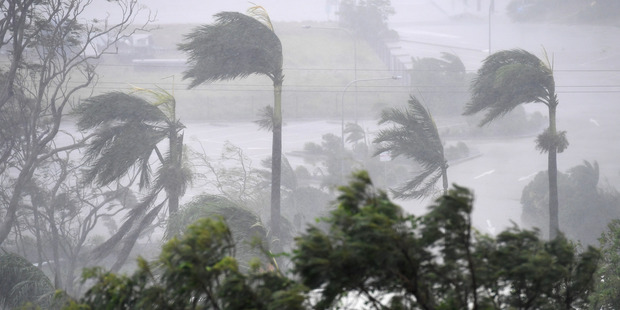 Loading Strong winds and rain lashed Airlie Beach yesterday as Cyclone Debbie hit. Photo / AAP