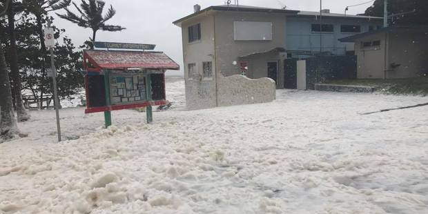 Sea foam whipped up from Cyclone Debbie in Queensland. Photo / Facebook