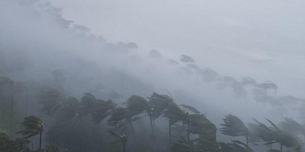 Cyclone Debbie makes landfall at Catseye beach, Hamilton Island. Photo / @RevellNorquay Twitter
