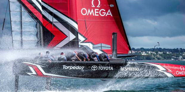 Loading Emirates Team New Zealand take their 50-ft America's Cup race boat for a spin on the Waitemata in the final week of training in Auckland. Photo: Hamish Hooper/ETNZ