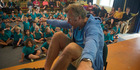 Mahe Drysdale meets Kaikoura primary school students and shows them how he sits in his boat when he races. Photo/Duffy Books