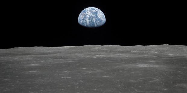 Earth rising over the moon's horizon, taken by the crew of Apollo 11. CREDIT: NASA