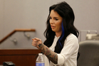 Christine Mackinday, also known as Christy Mack, points toward Jonathan Paul Koppenhaver, also known as War Machine, during a preliminary hearing. Photo / AP