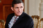 Former National Security Adviser Michael Flynn sits in the East Room of the White House in Washington. Photo / AP