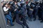 Police detain protesters in Pushkin Square, downtown Moscow, Russia. Photo / AP