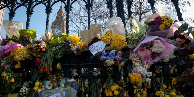Floral tributes to the victims of the Westminster terrorist attack placed outside the Palace of Westminster. Photo / AP