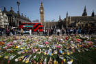 Floral tributes to the victims of the Westminster attack are placed outside the Palace of Westminster in London earlier this week. Photo / AP
