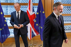 Britain's permanent representative to the European Union Tim Barrow, right, leaves after he delivered British Prime Minister Theresa May's Brexit letter to EU Council President Donald Tusk. Photo / AP