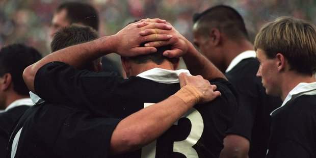 Ant Strachan is comforted by Frank Bunce after the 1995 World Cup final defeat.